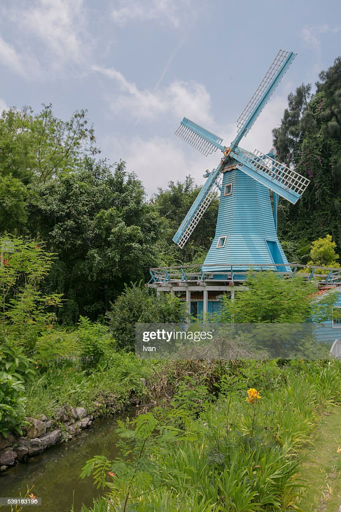 Blue Windmill in a Gordon with River against Blue Sky : Stock Photo