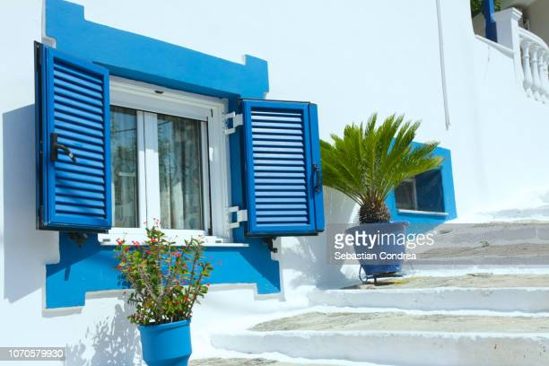 blue windows of typical greek, in alley in parga city epirus,travel, island, greece - epirus greece stock pictures, royalty-free photos & images
