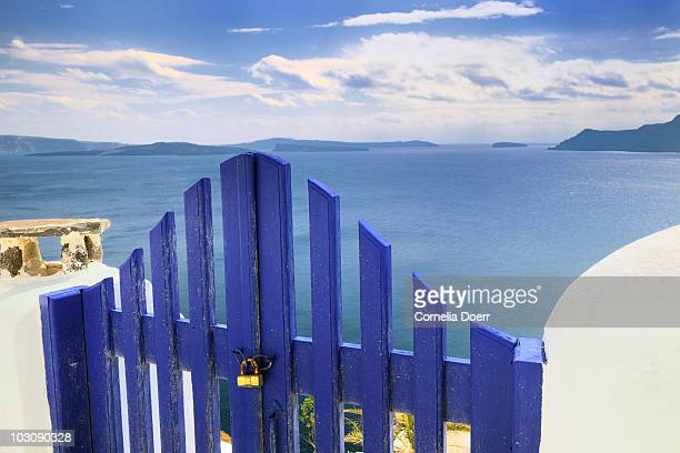 Blue wooden gate with lock above Sea