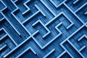 Blue wooden labyrinth maze puzzle close up