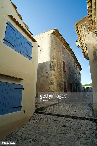 Blue wooden sunblinds / louvre boards of traditional house in alley of the village Banon AlpesdeHauteProvence Provence France