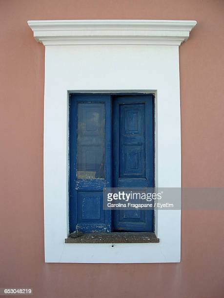 blue wooden window of house - carolina fragapane stock pictures, royalty-free photos & images