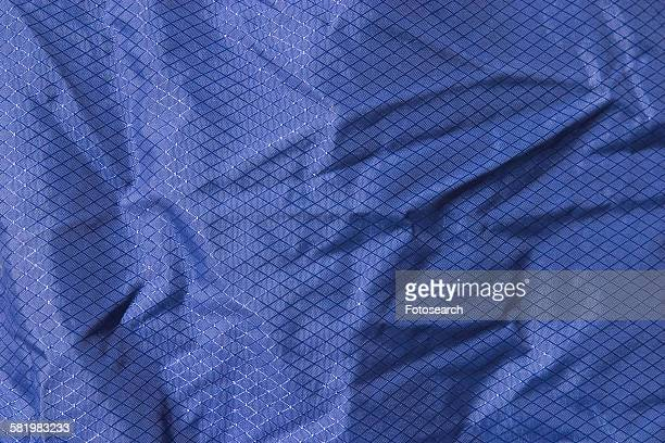 blue wrinkled fabric - stiches stock photos and pictures