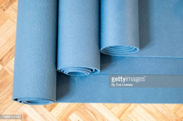 blue yoga mats - herringbone floor stock photos and pictures
