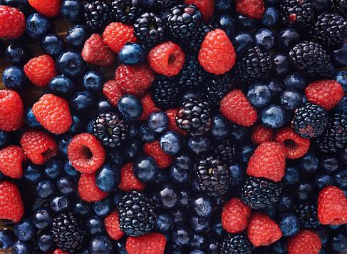 blueberies, raspberries and black berries shot top down 485349336