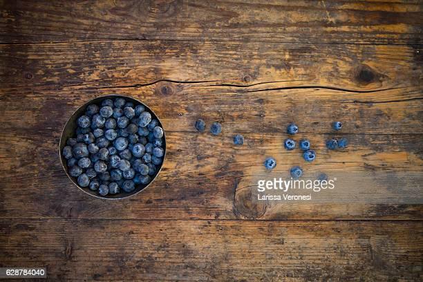 Blueberries in metal bowl on dark wood