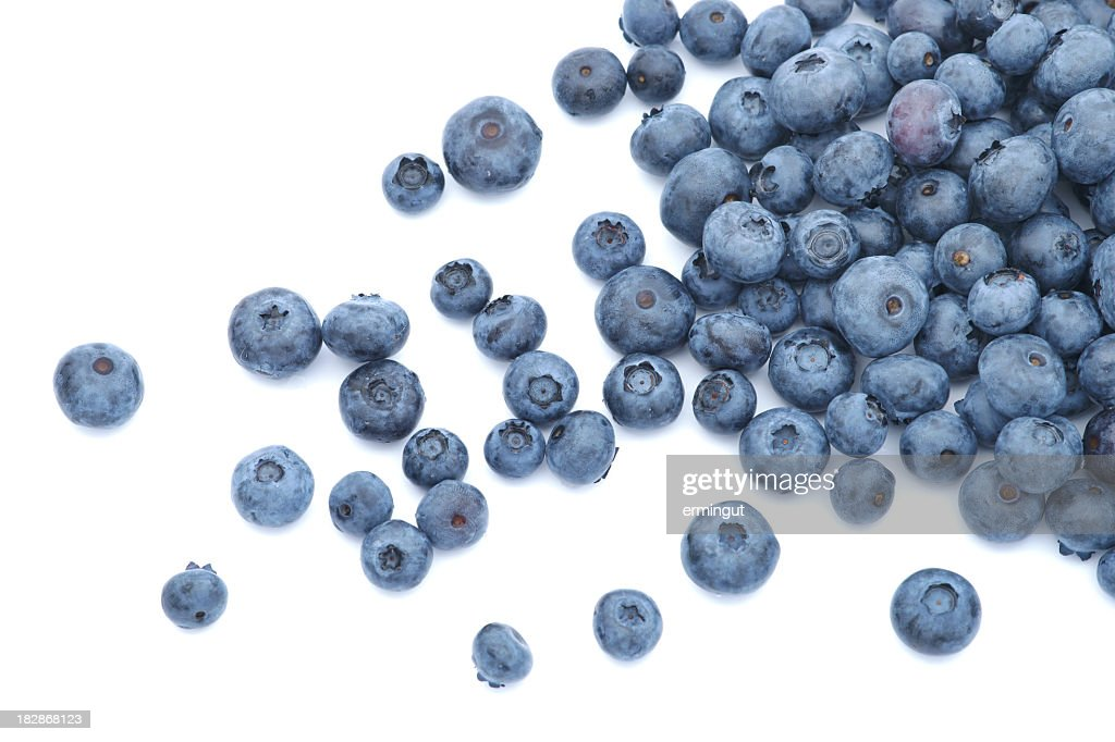 Blueberries scattered on white background : Stock Photo