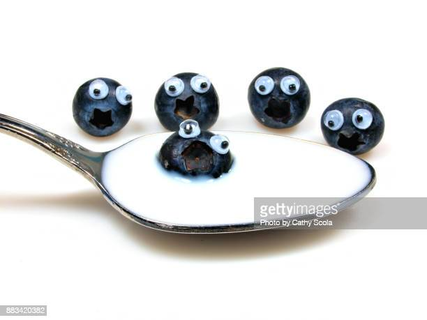 blueberries with eyes - googly eyes stock pictures, royalty-free photos & images
