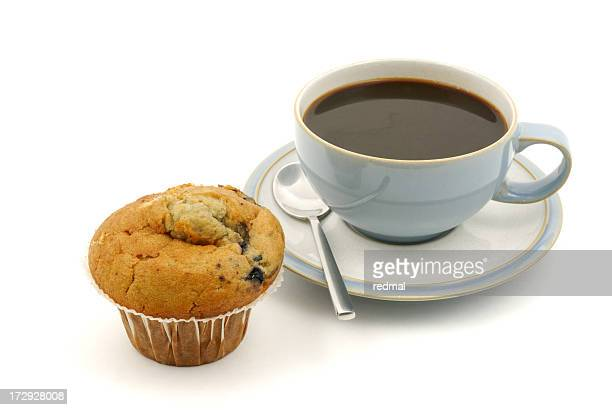 A blueberry muffin and a black coffee on a white background
