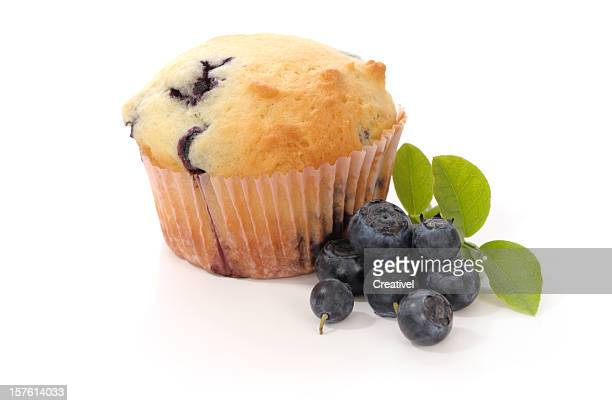 Blueberry Muffin and fresh blueberries, isolated on white