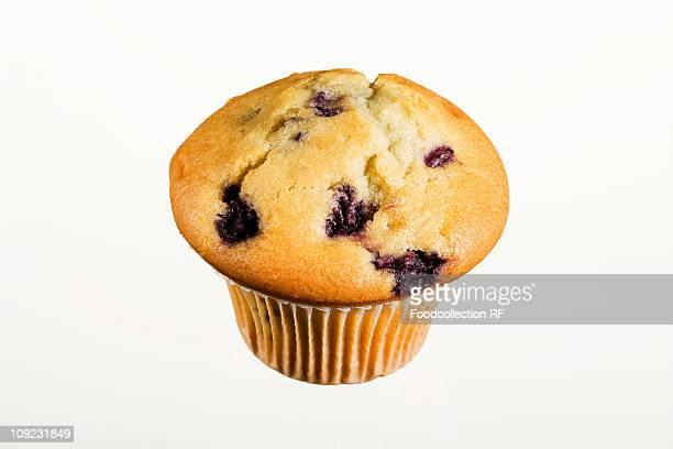 Blueberry muffin on white background, close-up