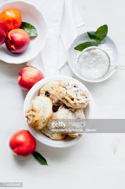 blueberry scones served with caster sugar and fresh fruits - scone - fotografias e filmes do acervo