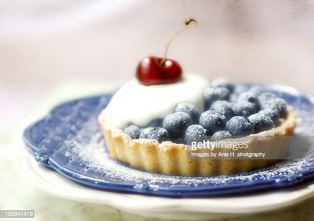 Blueberry tartlets with cherry on top