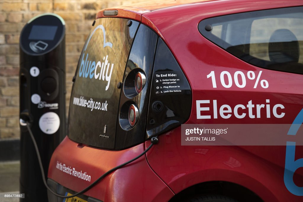 A Bluecity electric car, part of a car sharing scheme, is charged ...