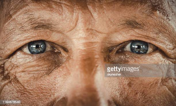blue-eyed senior man. - extreme close up stock pictures, royalty-free photos & images