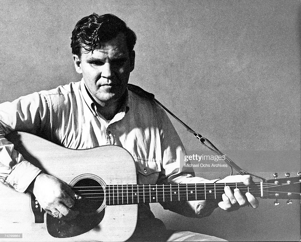 Bluegrass musician Doc Watson pose for a portrait with an acoustic guitar in circa 1968.