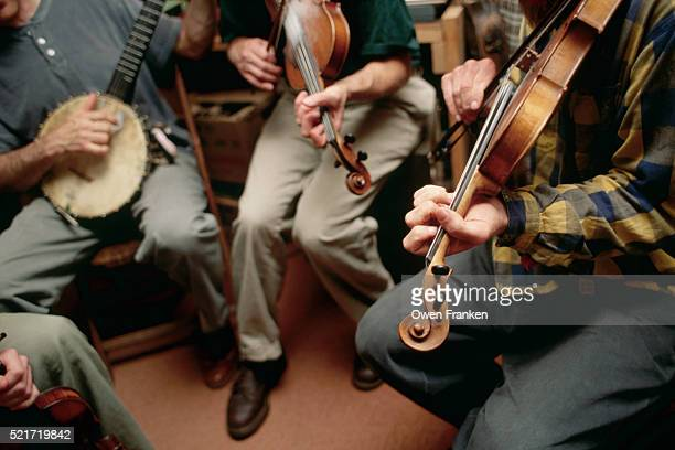 bluegrass musicians rehearsing - country and western music stock pictures, royalty-free photos & images