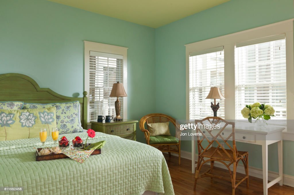 Blue-green bedroom with breakfast in bed : Stock Photo