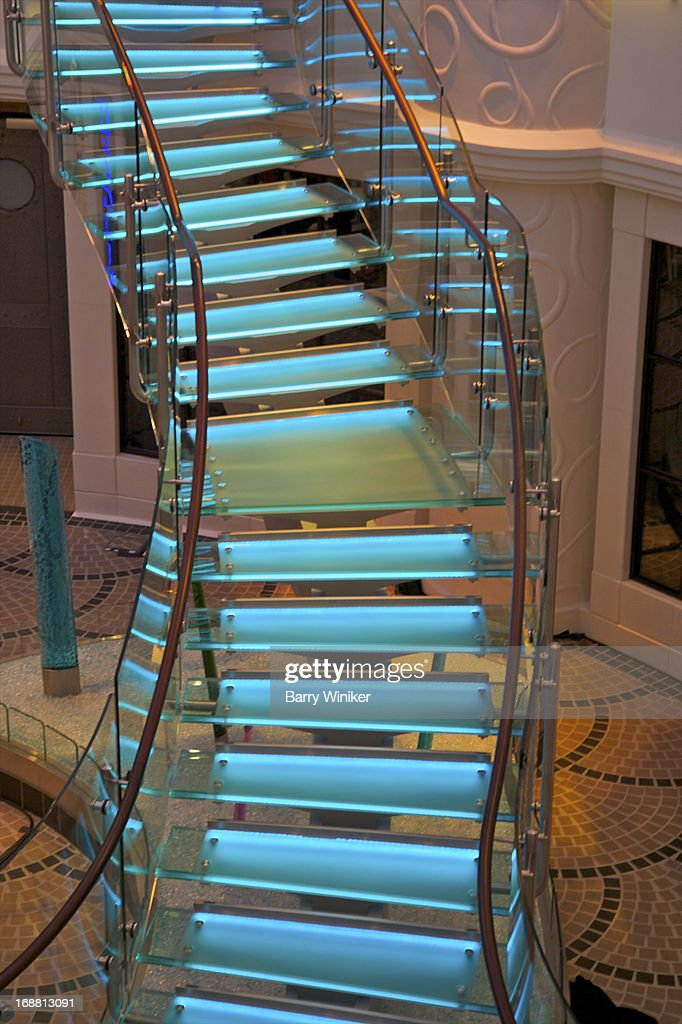 Blue-lit free-form staircase. : Stock Photo