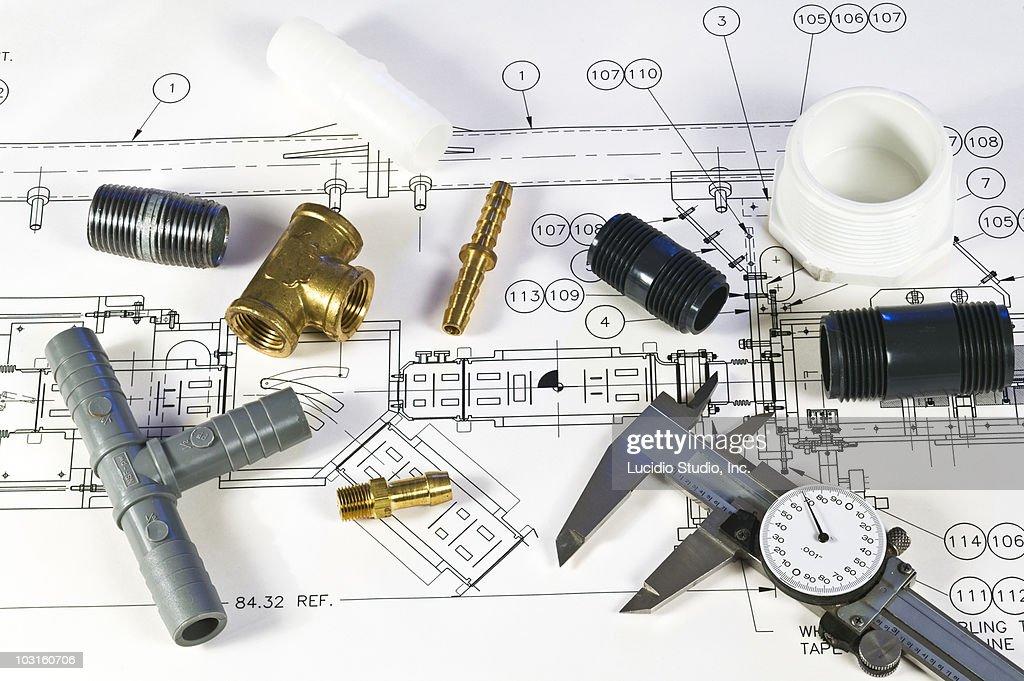 Blueprint and plumbing items : Stock Photo