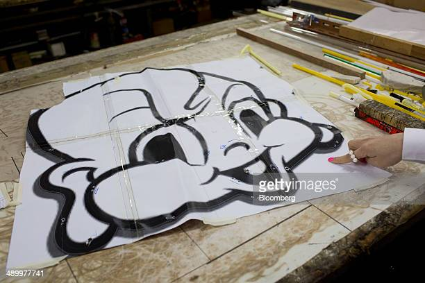 A blueprint drawing of the logo for the Little Bao restaurant sits on a table at Nam Wah Neonlight Electrical Mfy Ltd in Hong Kong China on Monday...