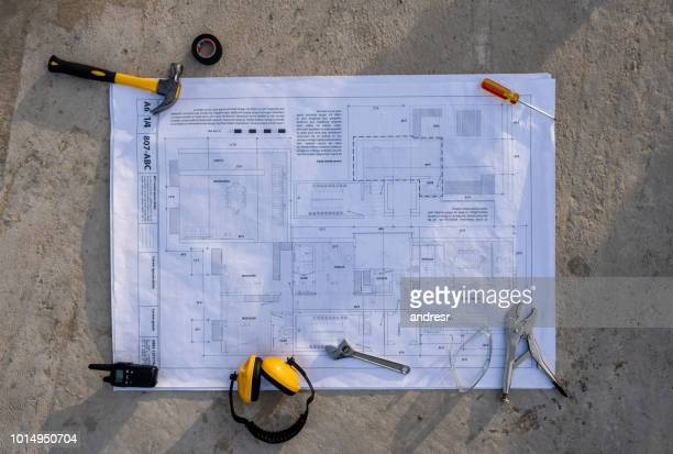 Blueprint on the floor at a construction site