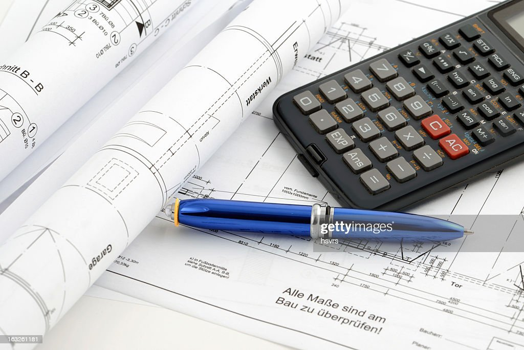 Blueprint plan of house building with calculator stock photo getty blueprint plan of house building with calculator stock photo malvernweather Images