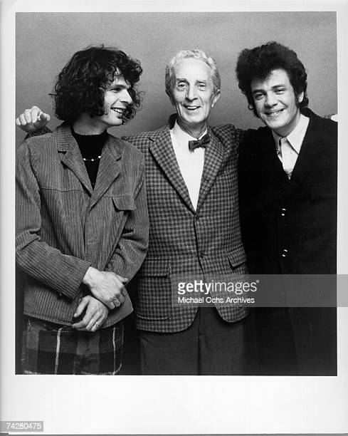 Blues and rock performers Al Kooper and Mike Bloomfield pose with artist Norman Rockwell who painted the cover of their album 'The Live Adventures of...