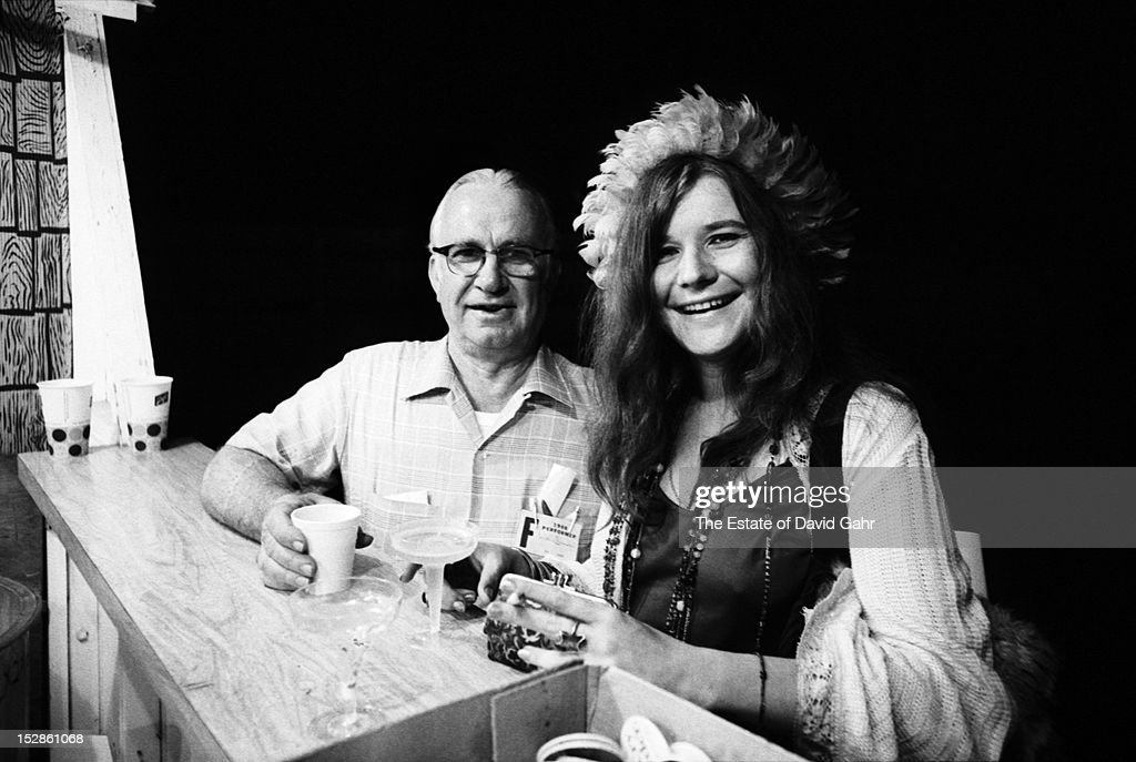 Blues and rock singer songwriter Janis Joplin poses for a portrait with Kenneth Threadgill, country singer and the proprietor of Threadgill's, the Austin, Texas music bar where Janis Joplin first made her fame as a singer, in July, 1968 at the Newport Folk Festival in Newport, Rhode Island.