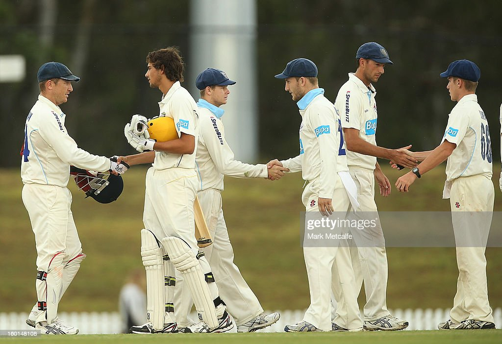 Blues and Warriors players shake hands at the conclusion of play after a drawn match on day four of the Sheffield Shield match between the New South Wales Blues and the Western Australia Warriors at Bankstown Oval on January 27, 2013 in Sydney, Australia.