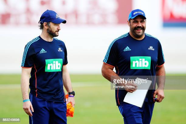 Blues assistant coach Alastair Rogers arrives with scrum coach Ben Afeaki for an Auckland Blues Super Rugby pre season training session ahead of the...