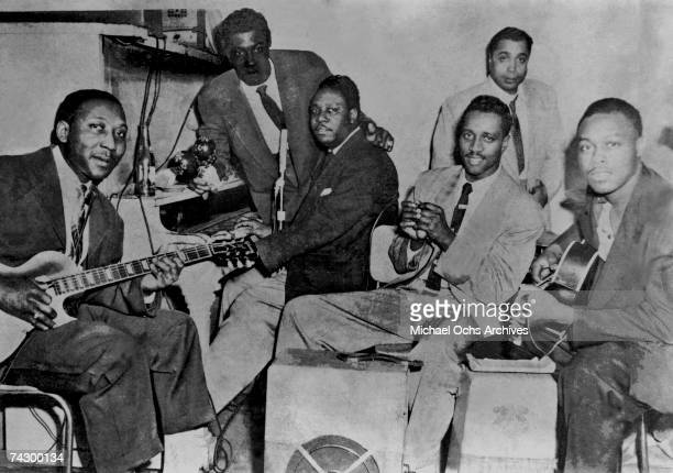 Blues band leader Muddy Waters with musicians Henry Armstrong Otis Spann Henry Strong Elga 'Elgin' Edmonds and Jimmy Rogers rehearses with his band...