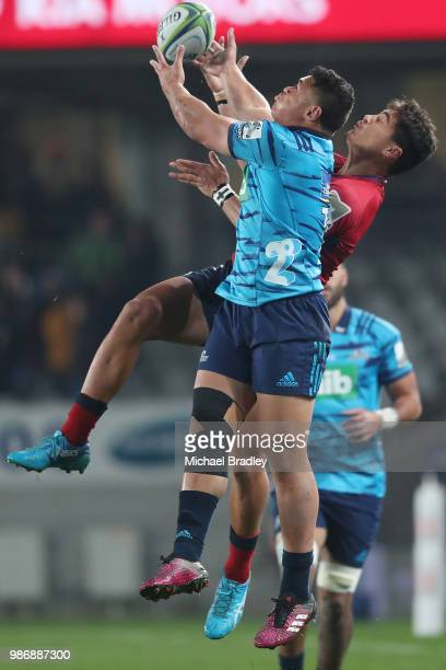 Blues Caleb Clarke and Reds Jordan Petaia compete for the high ball during the round 17 Super Rugby match between the Blues and the Reds at Eden Park...