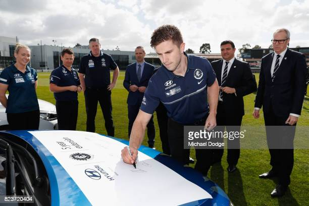 Blues Captain Marc Murphy signs a Hyundai car after the club signed a new five year sponsor agreement with the car maker during a Carlton Blues AFL...
