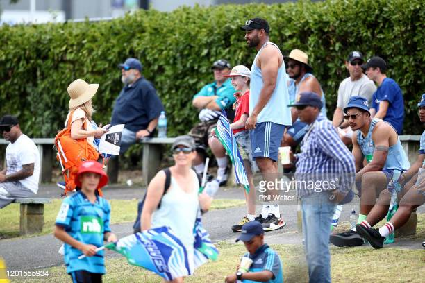 Blues captain Patrick Tuipulotu signs autographs during the Super Rugby pre-season match between the Blues and the Hurricanes at Onewa Domain on...