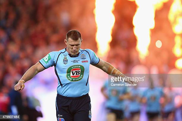 Blues captain Paul Gallen leads his team onto the field during game three of the State of Origin series between the Queensland Maroons and the New...