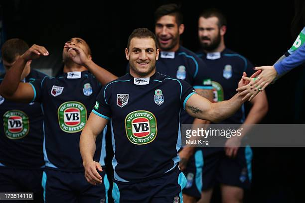 Blues captain Robbie Farah leads the team out during a New South Wales Blues State of Origin training session at ANZ Stadium on July 16 2013 in...