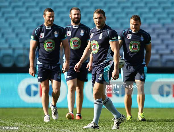 Blues captain Robbie Farah warms up with Blues players during a New South Wales Blues State of Origin training session at ANZ Stadium on July 16 2013...