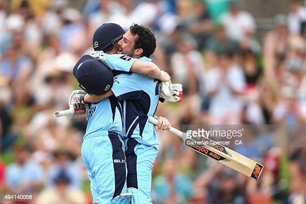 Blues captain Steve Smith and team mate Ed Cowan celebrate winning the Matador BBQs One Day Cup final match between New South Wales and South...