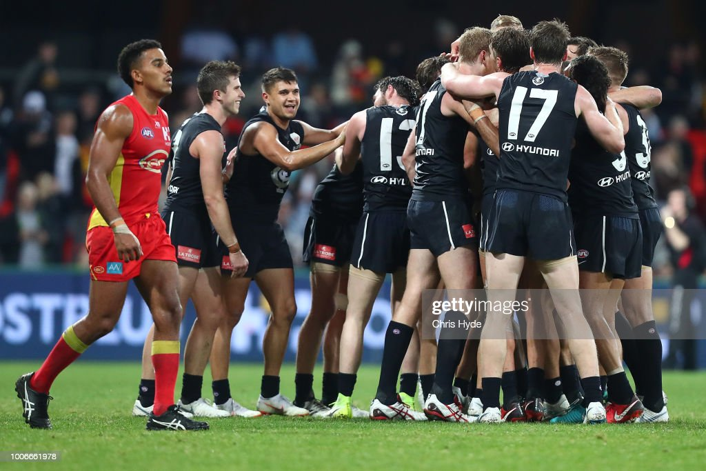 Blues celebrate winning the round 19 AFL match between the Gold Coast Suns and the Carlton Blues at Metricon Stadium on July 28, 2018 in Gold Coast, Australia.