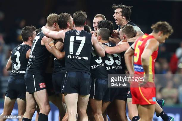 Blues celebrate winning the round 19 AFL match between the Gold Coast Suns and the Carlton Blues at Metricon Stadium on July 28, 2018 in Gold Coast,...