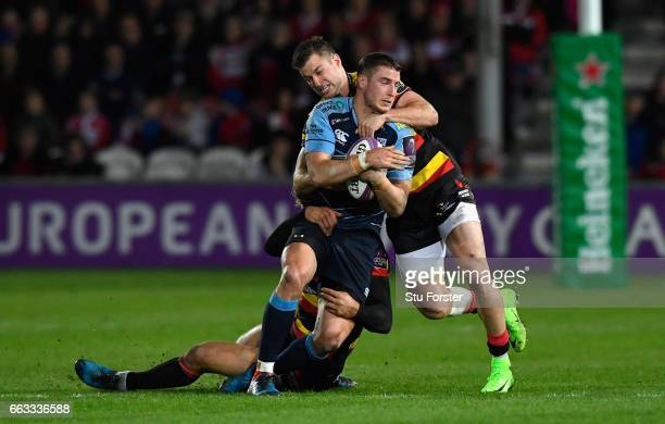 Blues centre Steven Shingler is tackled by Billy Twelvetrees and Henry Trinder of Gloucester during the European Rugby Challenge Cup match between...