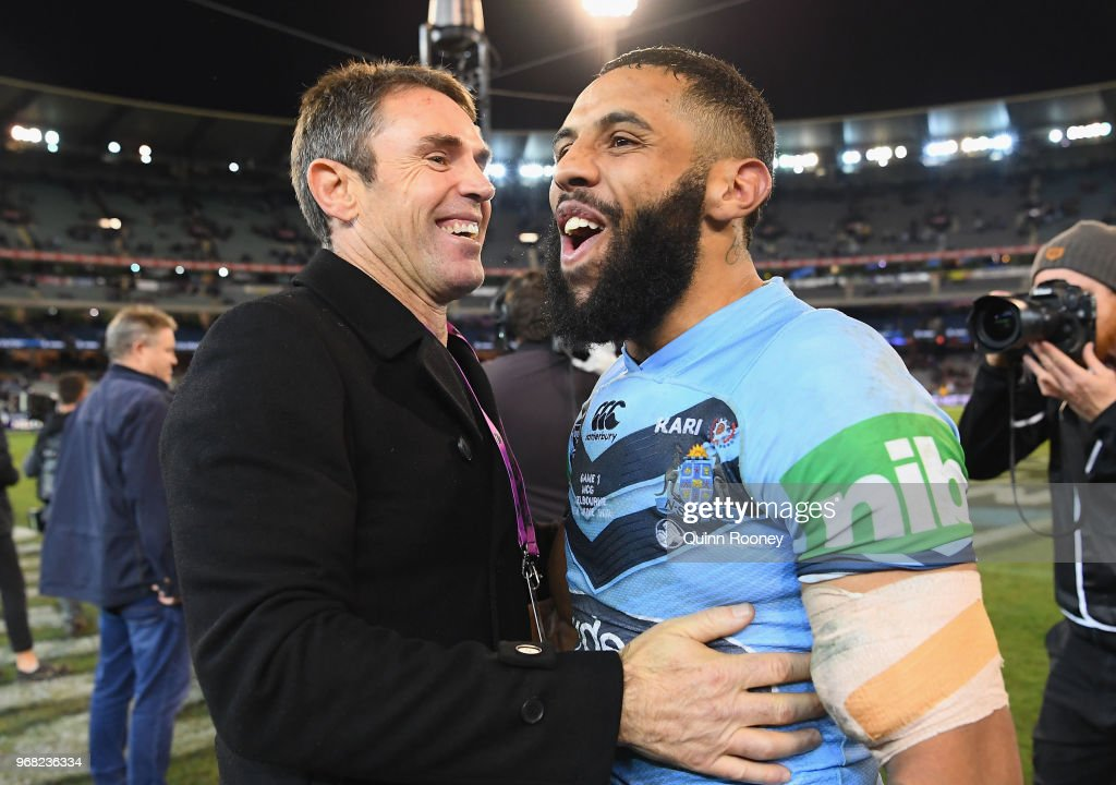 Blues coach Brad Fittler and Josh Addo-Carr of the Blues celebrate winning game one of the State Of Origin series between the Queensland Maroons and the New South Wales Blues at the Melbourne Cricket Ground on June 6, 2018 in Melbourne, Australia.