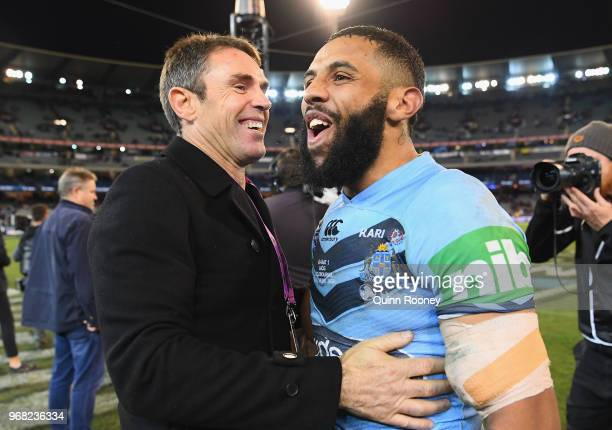 Blues coach Brad Fittler and Josh AddoCarr of the Blues celebrate winning game one of the State Of Origin series between the Queensland Maroons and...