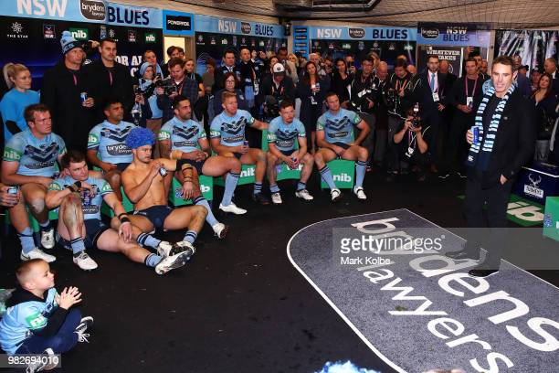 Blues coach Brad Fittler speaks to his team as they celebrate victory after game two of the State of Origin series between the New South Wales Blues...