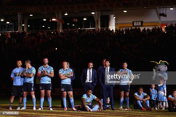 Blues coach Laurie Daley and his players look dejected after losing game three of the State of Origin series between the Queensland Maroons and the...