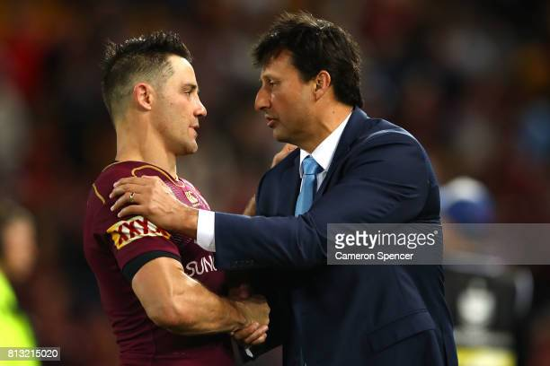 Blues coach Laurie Daley congratulates Cooper Cronk of the Maroons after game three of the State Of Origin series between the Queensland Maroons and...