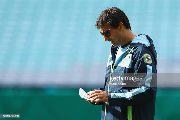 Blues coach Laurie Daley reads his notes during the New South Wales State of Origin captain's run at ANZ Stadium on May 31 2016 in Sydney Australia