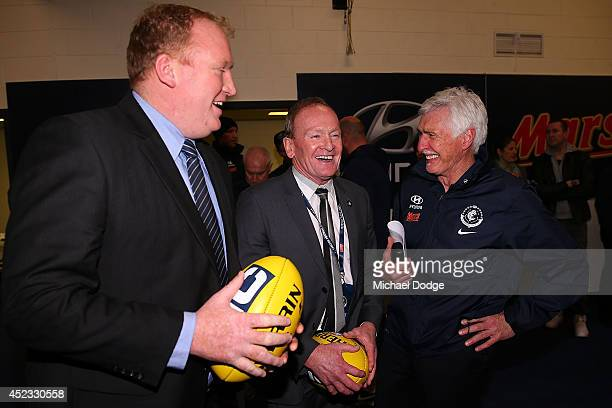 Blues coach Michael Malthouse celebrates the win with former players Lance Witnall and Phil Maylin during the round 18 AFL match between the Carlton...