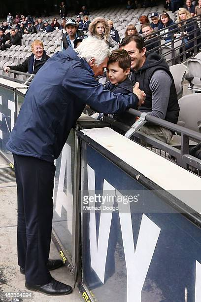Blues coach Michael Malthouse greets his grandson before the round 20 AFL match between the Carlton Blues and the GOld Coast Titans at Etihad Stadium...
